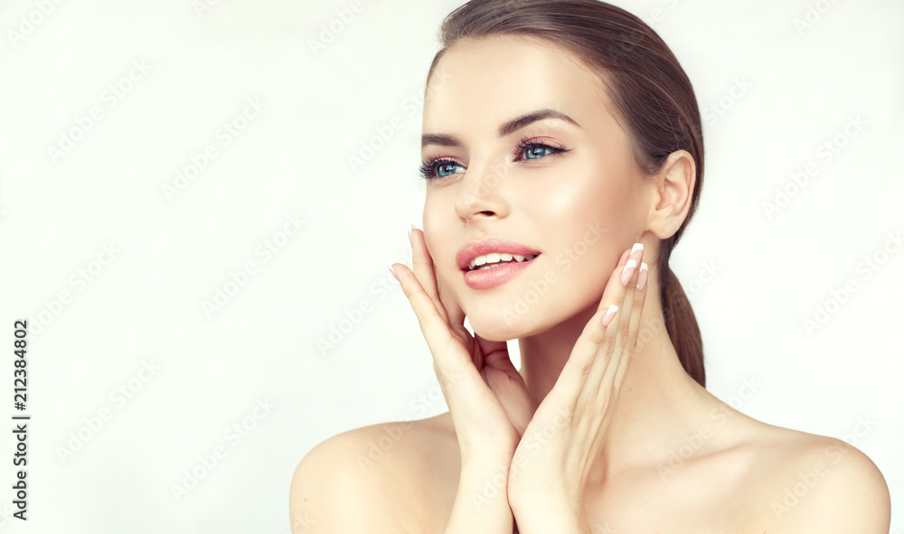 Fototapeta Beautiful young woman with clean fresh skin .Girl beauty face care. Facial treatment . Cosmetology , beauty and spa .