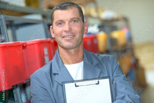 Fotografie, Obraz  Portrait of man holding blank clipboard