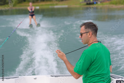 Fotografie, Obraz  unidentified participant shows her skills during an open waterski competition