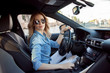 Young attractive woman driving her car. Portrait of a successful business woman