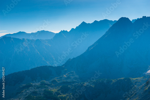 high beautiful mountains of the Tatra in the haze on a sunny day, landscape