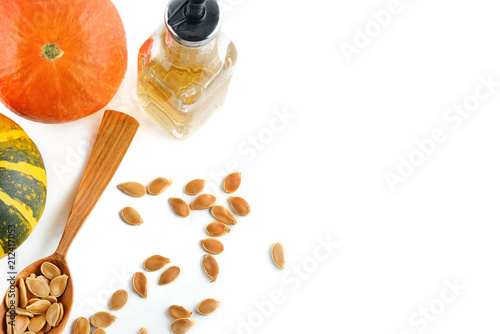 Spoed Foto op Canvas Kruiderij Fresh pumpkin oil isolated on white background. Flat lay, top view. Free space for text.