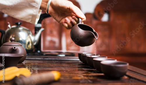 Tea ceremony, Woman pouring traditionally prepared Chinese tea