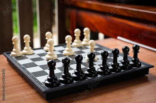 Fotografia, Obraz  Chess white pawn invade (attack) black pawn for leader background or texture - Business & Strategy Concept