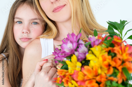 Beautiful Flower Gift On Moms Birthday Loving Daughter Hugginh Her Mom Holding A Present