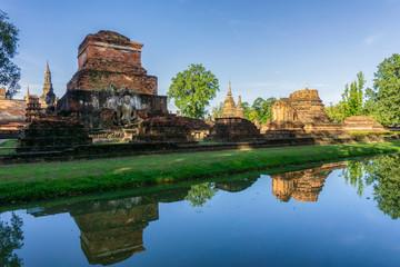 Fototapeta na wymiar Wat Mahathat Temple in the precinct of Sukhothai Historical Park, Thailand