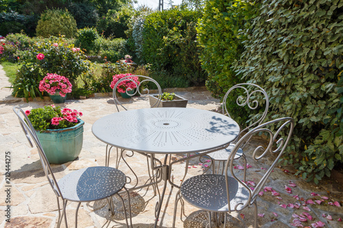 Terrasse fleurie avec salon de jardin - Buy this stock photo and ...
