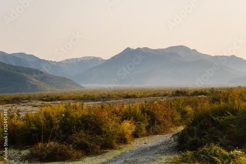 Fototapeta Charming nature, high mountains and hills at sunset, summer landscape obraz na płótnie