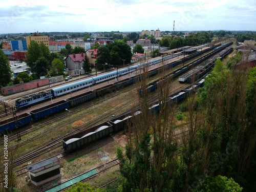 Staande foto Treinstation Cargo and passenger wagons on train station in city, aerial view