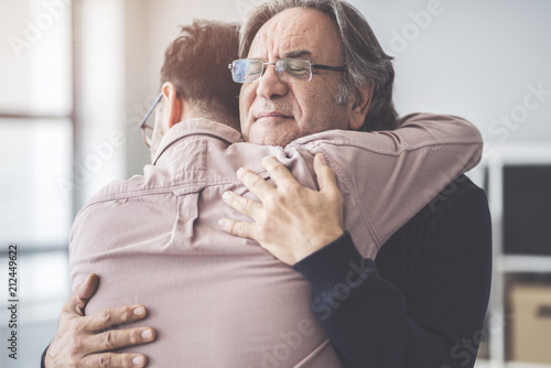 Fotografie, Tablou Son hugs his own father