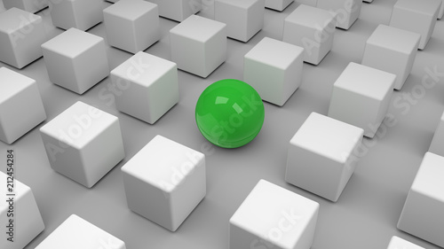 Photo  Eine einzelne grüne Kugel inmitten einer Gruppe von grauen Würfeln