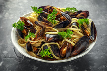 White Wine And Garlic Steamed Mussels With Pasta Served With Parsley