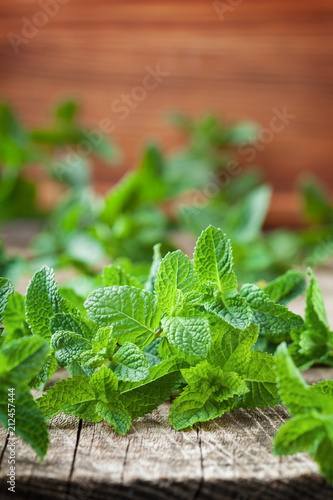 Fresh mint leaves on wooden background.