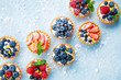 canvas print picture - Healthy summer pastry dessert. Berry tartlets or cake with cream cheese top view.