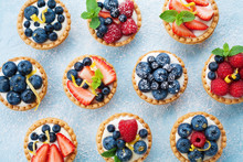 Berry Tartlets Background. Delicious Summer Pastry Dessert Top View.