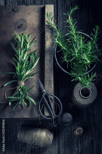 Poster Aromatische Fresh green rosemary in a rustic kitchen
