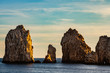 Cabo San Lucas is the most famous travel destination in Baja California. Rock formations close to the shores of Cabo San Lucas at sunset.