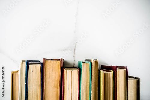 Fényképezés  Back to school background with old books, alarm clock, pencils