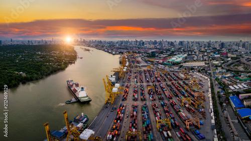 Billede på lærred Aerial view of international port with Crane loading containers in import export
