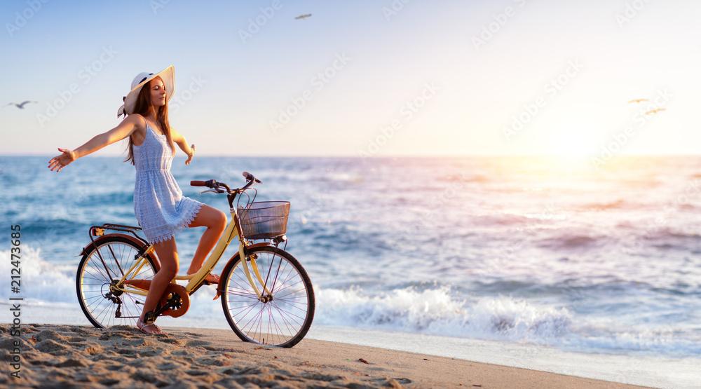 Fototapeta Girl On Bicycle On Beach - Freedom And Carefree Concept  - obraz na płótnie