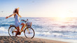 canvas print picture - Girl On Bicycle On Beach - Freedom And Carefree Concept