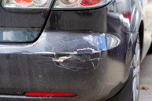 Black Car Dent Rear Bumper In The Street  Broken