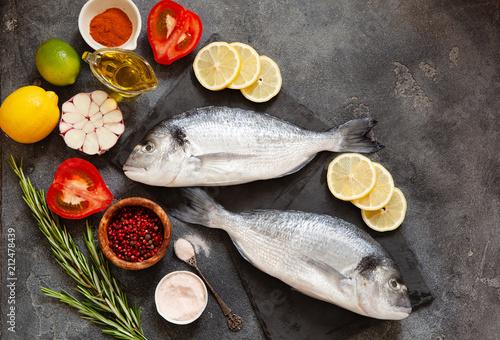 Fotografie, Obraz  Raw dorado fish with spices on cutting board