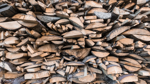 Poster Brandhout textuur Wooden natural sawn a logs close up, texture for background, front view