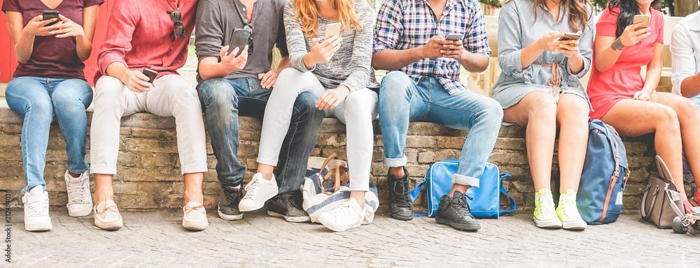 Fototapeta Happy millennials friends surfing online with mobile phones