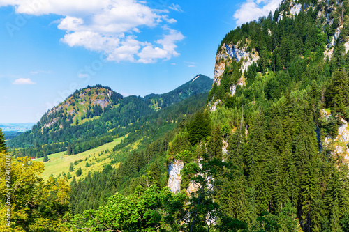 Staande foto Blauw Scenic summer landscape with mountains, hills and forest