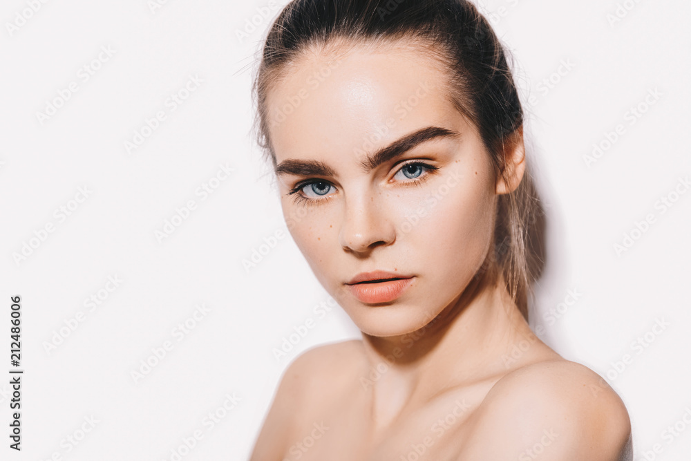 Fototapeta Beauty portrait of female model with perfect eyebrows with natural make up and healthy skin. Cosmetology and skin care concept