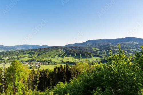 Foto op Plexiglas Blauwe hemel Majestic landscape of mountains and Meadow. Cycling mountain road. Misty mountain road in high mountains.. Cloudy sky with mount