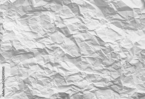 Valokuva  Crumpled paper. White pattern texture background.
