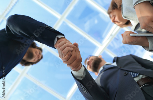 Valokuva Successful business people handshake greeting deal concept