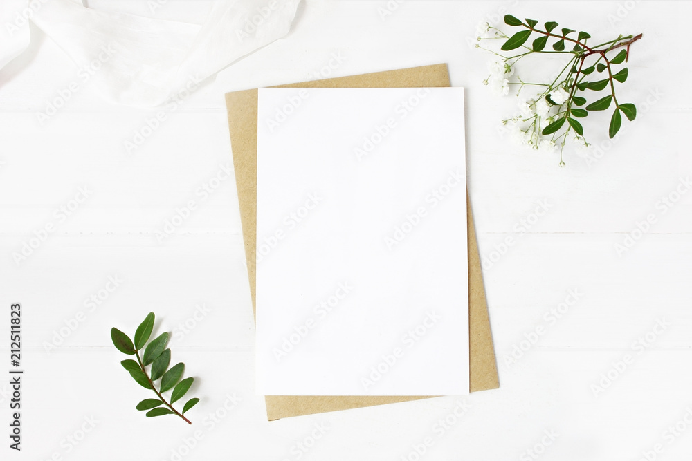 Fototapety, obrazy: Feminine wedding stationery, desktop mock-up scene. Blank greeting card, craft envelope, baby's breath flowers, silk ribbon and lentisk branches. Old white wooden table background. Flat lay, top view.