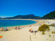 Beach of Cies Islands, in Galicia, Spain, with boats docked in front of