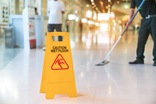 Low Section Of Worker Mopping ...