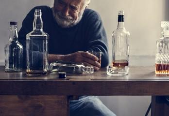 Fototapeta Elderly man drinking alcohol