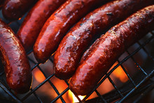 Grilled Sausages Grill Flames Close Up BBQ Background