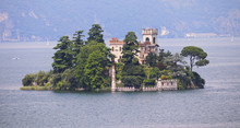 Isola Di Loreto, Tiny Island Inside Iseo Lake, Lombardy, Italy, Old Castle Surrounded By Trees With Mainland On The Background