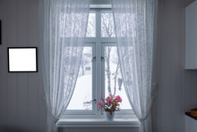 Pink Flower On Window Sill With Curtain And Picture Frame On Winter Season