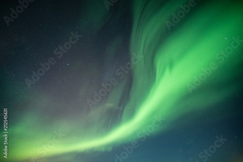 Deurstickers Noorderlicht Beautiful Northern lights, Aurora borealis dancing on night sky