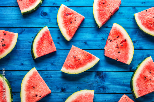 Top of view pieces of fresh watermelon on blue table
