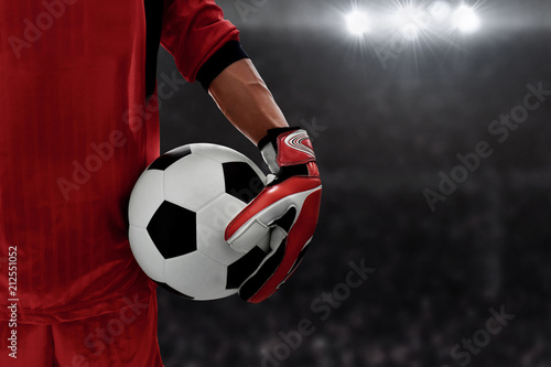 Soccer goalkeeper holding soccer ball Fototapeta