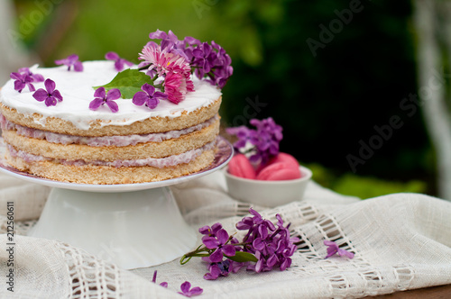 Poster Dessert Sweet dessert, wedding cake with flowers and fruits on the background of nature