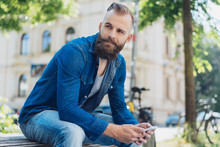 Young Bearded Man In Denim Shi...