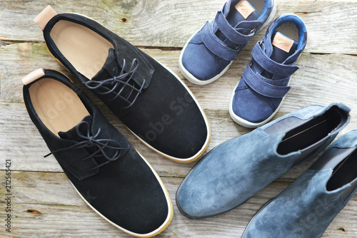 Top view of family shoes on wooden floor, family concept