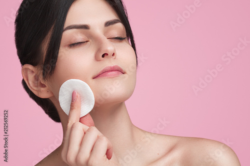 Fotografie, Obraz  Beautiful young woman caring for face