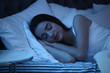 canvas print picture - Young woman sleeping in bed at night. Sleeping time