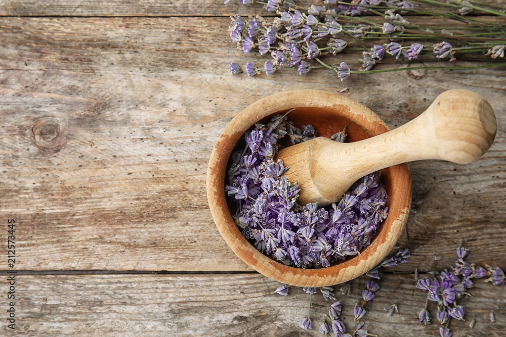 Fototapety, obrazy: Mortar with lavender flowers on table, top view. Ingredient for natural cosmetic